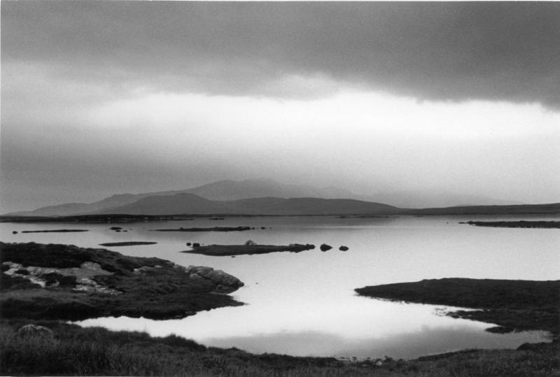 Moody landscape. Lochans, hills, South Uist. Black and white