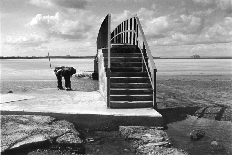 Bridge at Belhaven Bay, Dunbar, two figures. Black and white