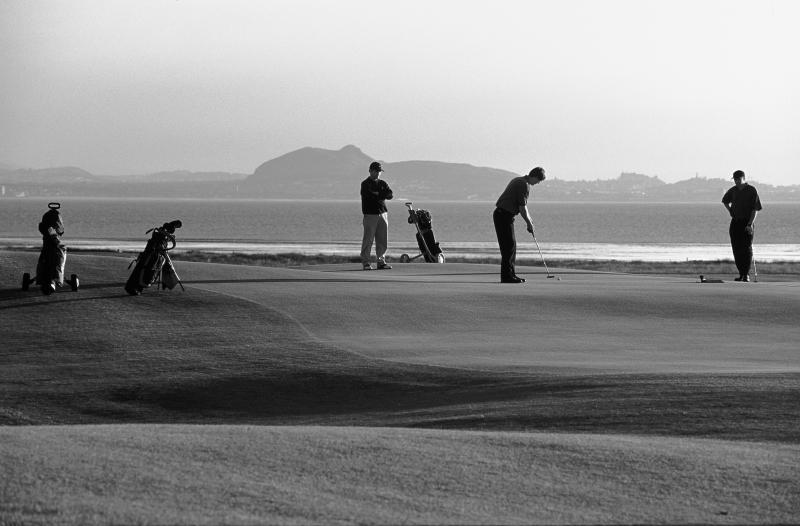 Craigielaw golf course, East Lothian, 13th Green. Arthurs Seat. Black and white