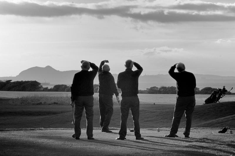 Longniddry golf course. Four golfers. Arthur's seat background. Black and white