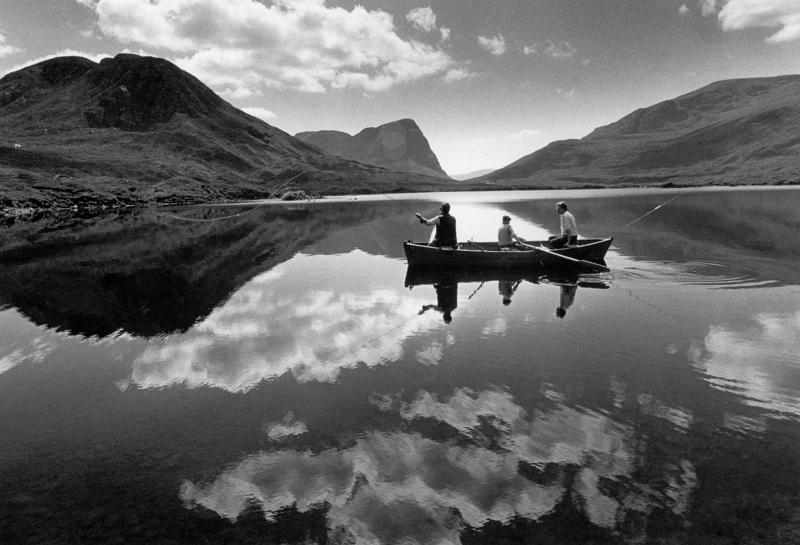 Loch fishing from boat, isle of Harris. Black and white