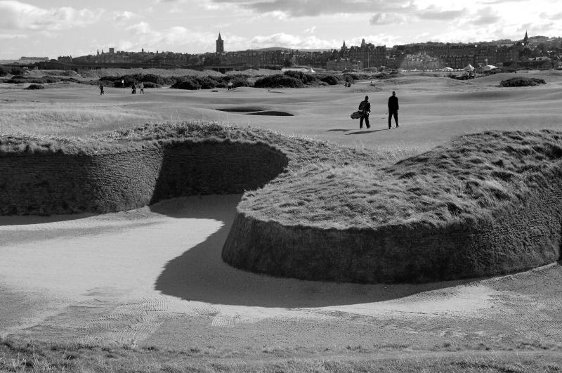 St Andrews Old Course. Hell bunker. Golfers. Black and white