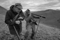 Kingie estate. Invergarry. Scottish highlands. Deer stalkers spying through telescope. Black and white