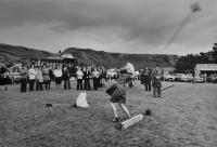 Woman tossing the broom, Dunbeath Highland Games